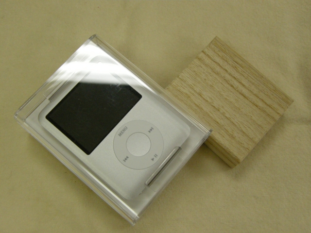 An iPod and a Small Wooden Box